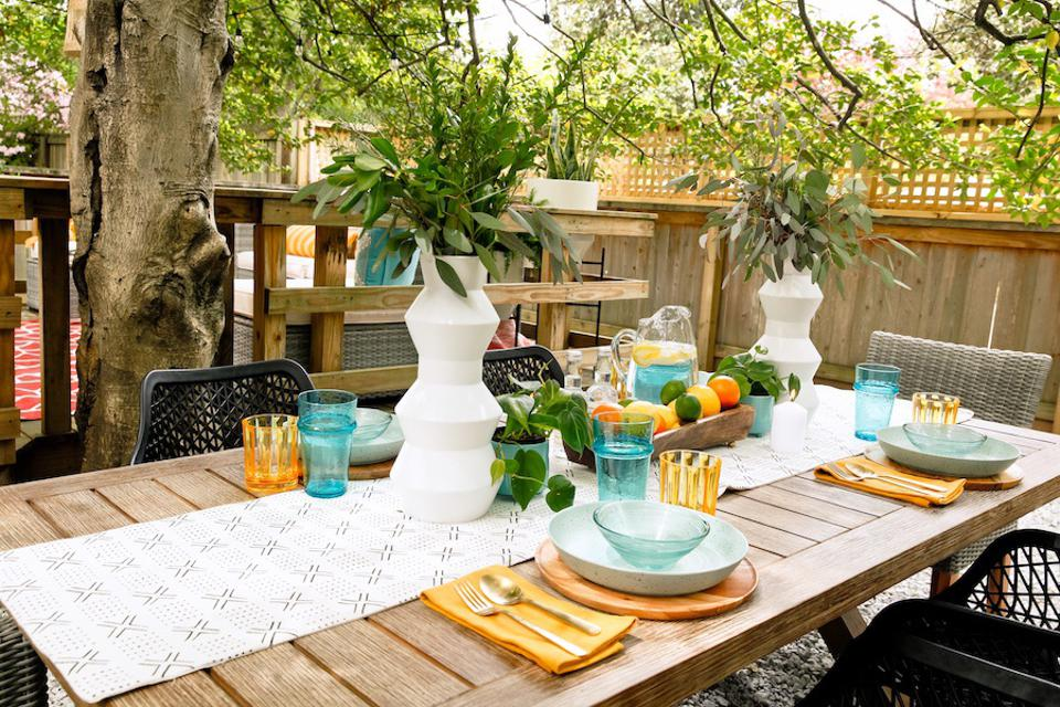A wood table with place settings.