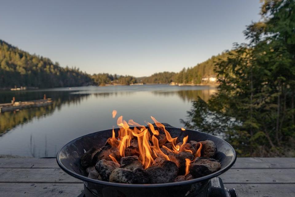 A firepit by a lake