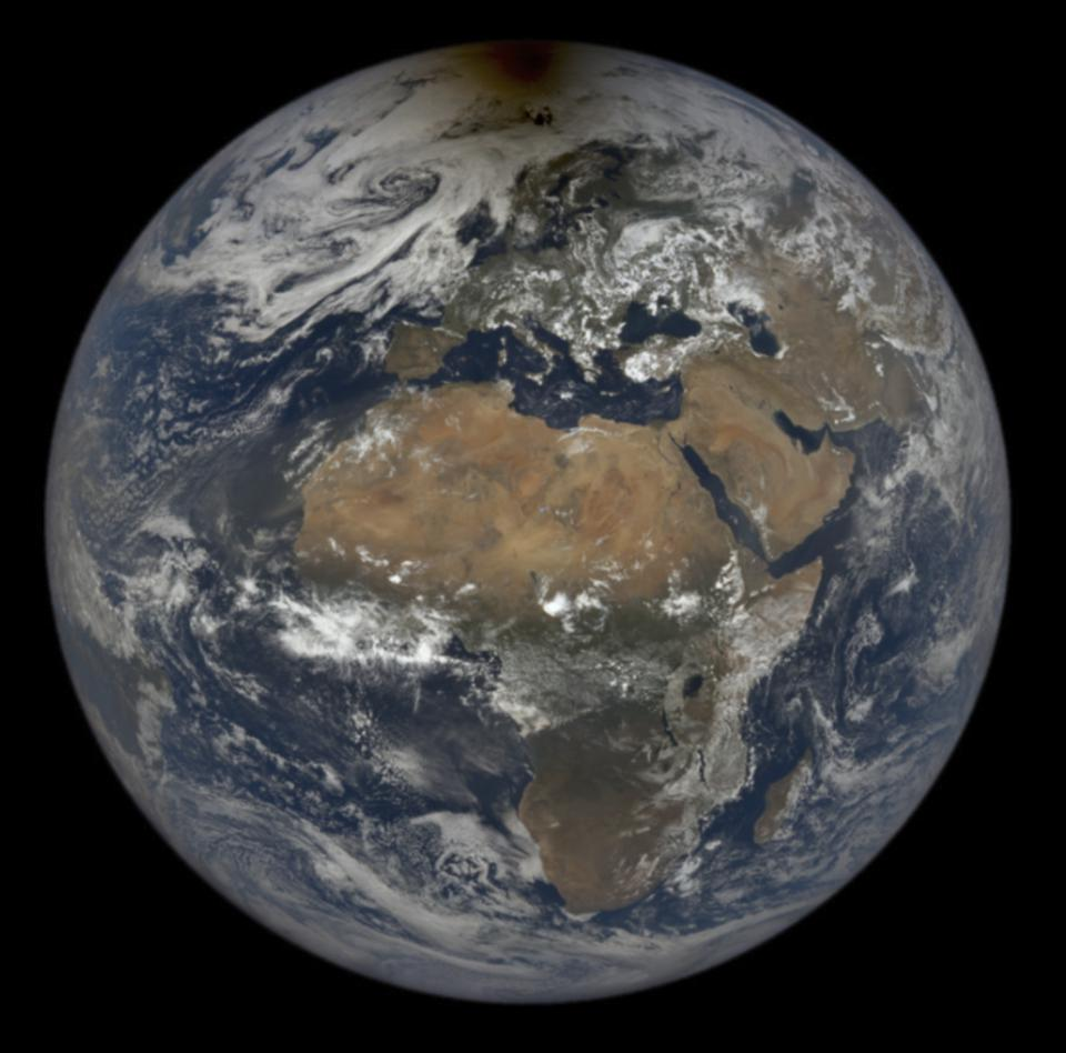 The Moon's shadow from yesterday's eclipse is easily visible on top of the Earth in this image from NASA's EPIC satellite.