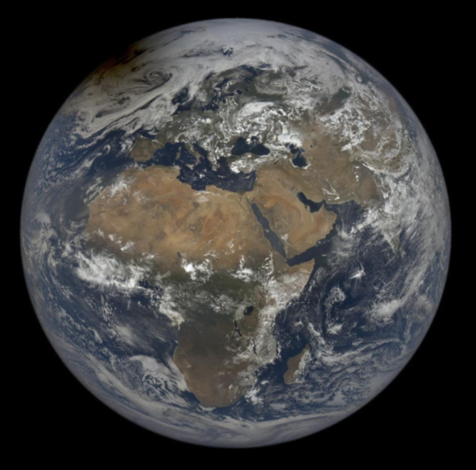 The Moon's shadow from yesterday's eclipse is visible on top left of the Earth in this image from NASA's EPIC satellite.