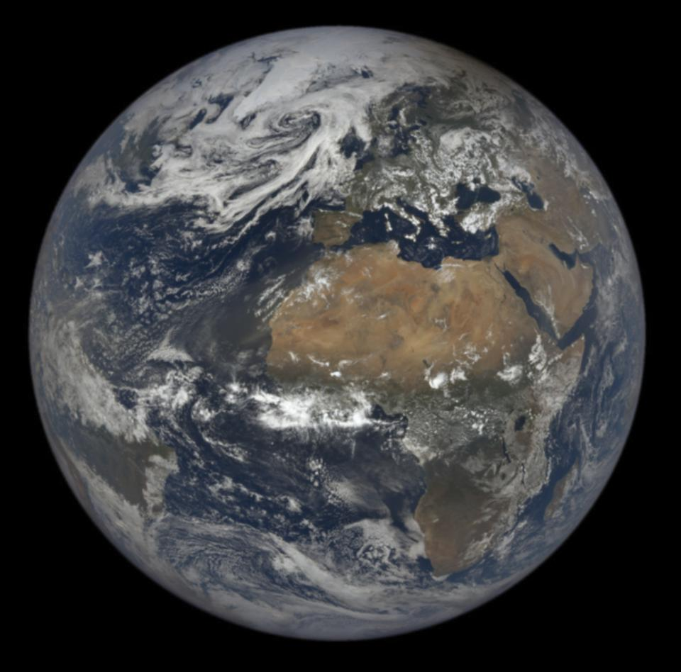 The Moon's shadow from yesterday's eclipse is visible on top right of the Earth in this image from NASA's EPIC satellite.