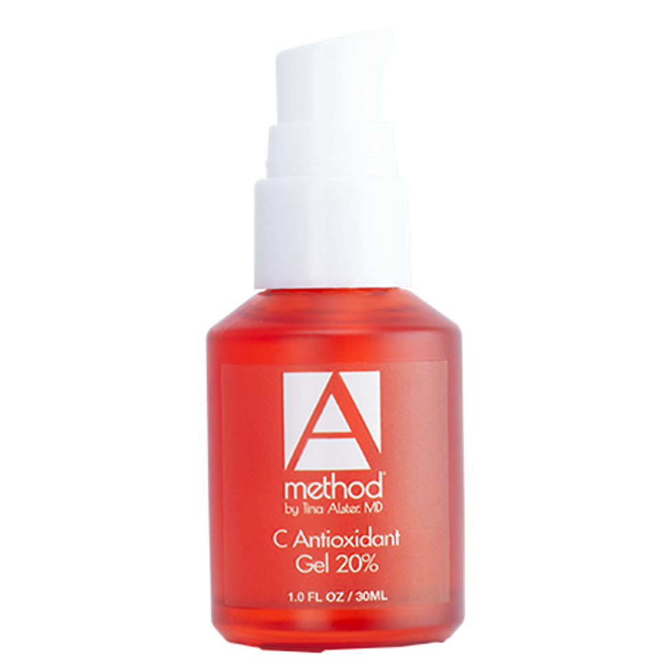 a red bottle of skin care serum