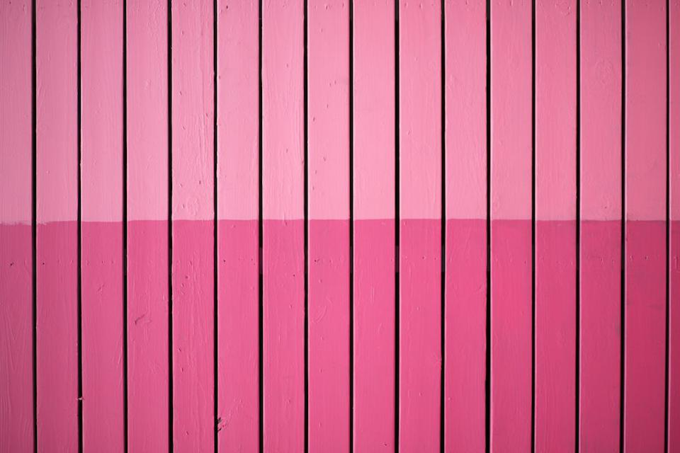 A fence painted two shades of pink