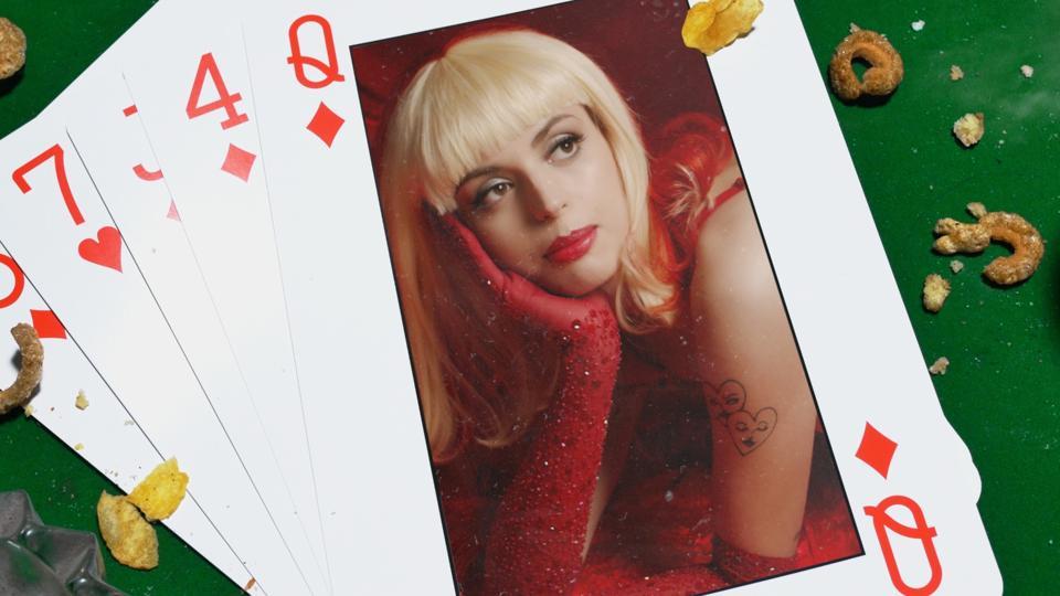 A screenshot of Rebecca Black in a playing card.