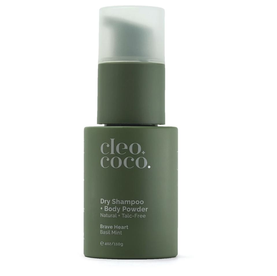 green bottle of dry shampoo