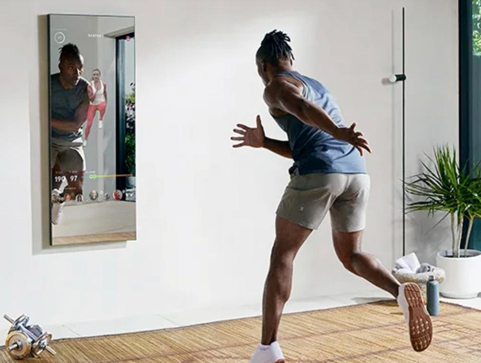 a man working out in front of a mirror
