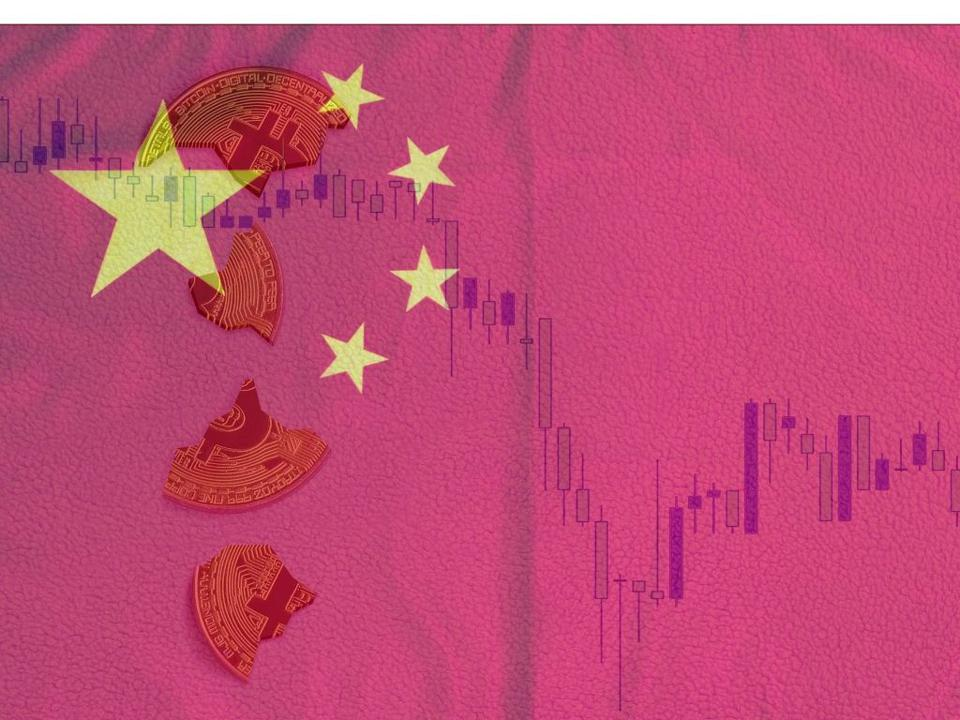 Broken Bitcoins fall over a Chinese flag.