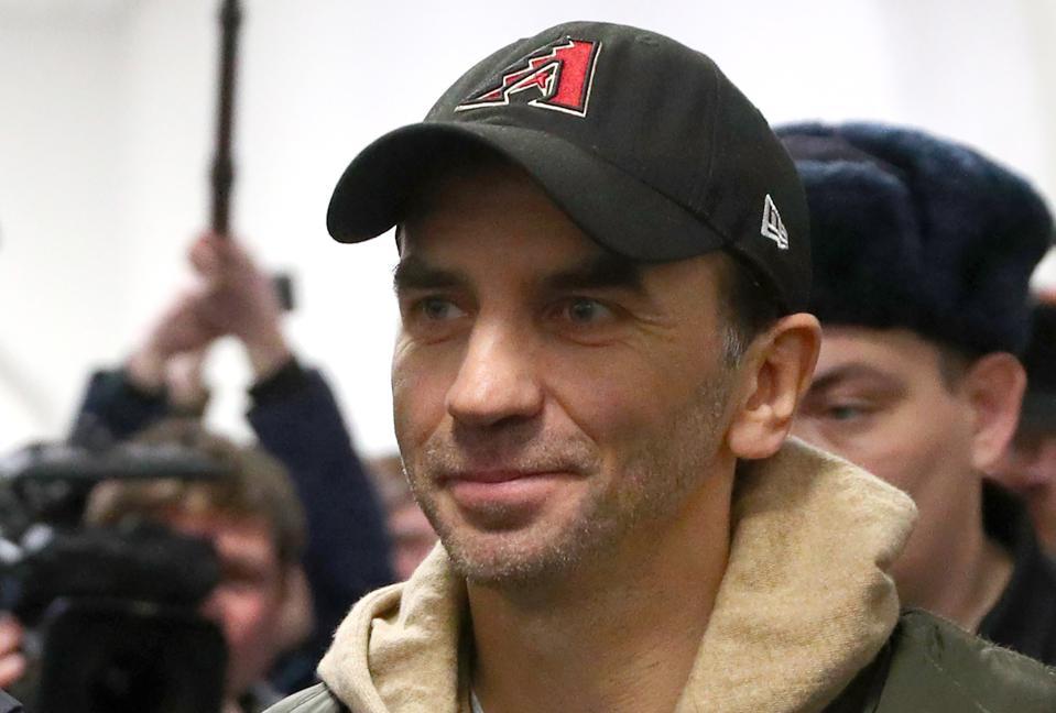 Mikhail Abyzov, a former Russian official, is seen wearing an Arizona Diamondbacks hat.