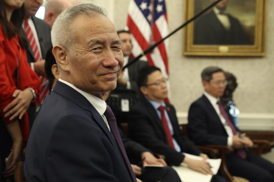 China's Vice Premier Liu He squints into the camera at the White House.