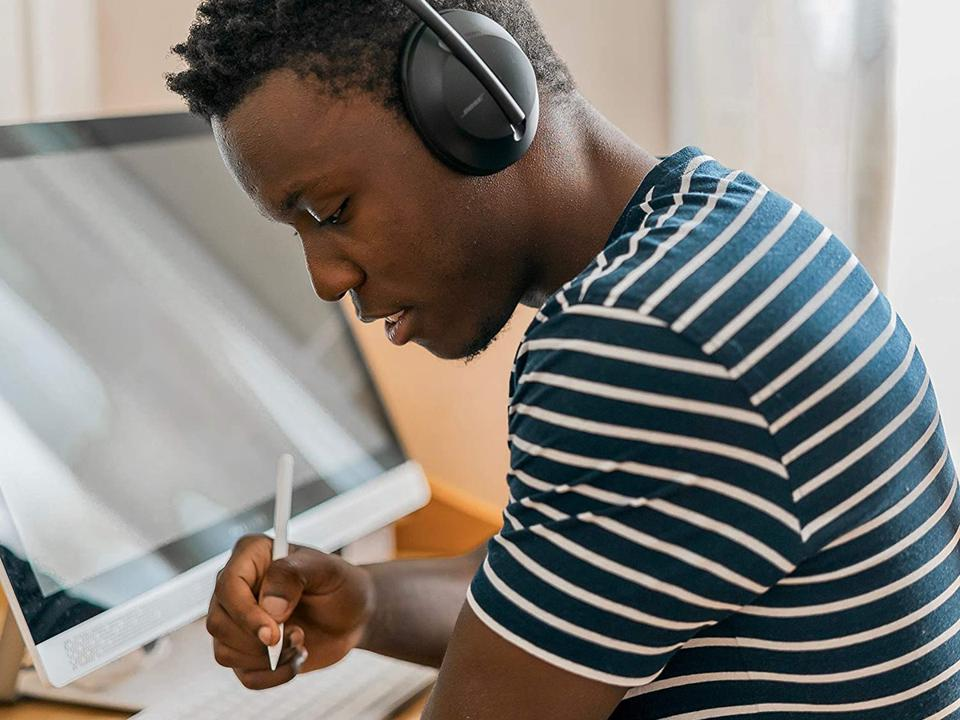 Early Prime Day Deals: man wearing Bose headphones