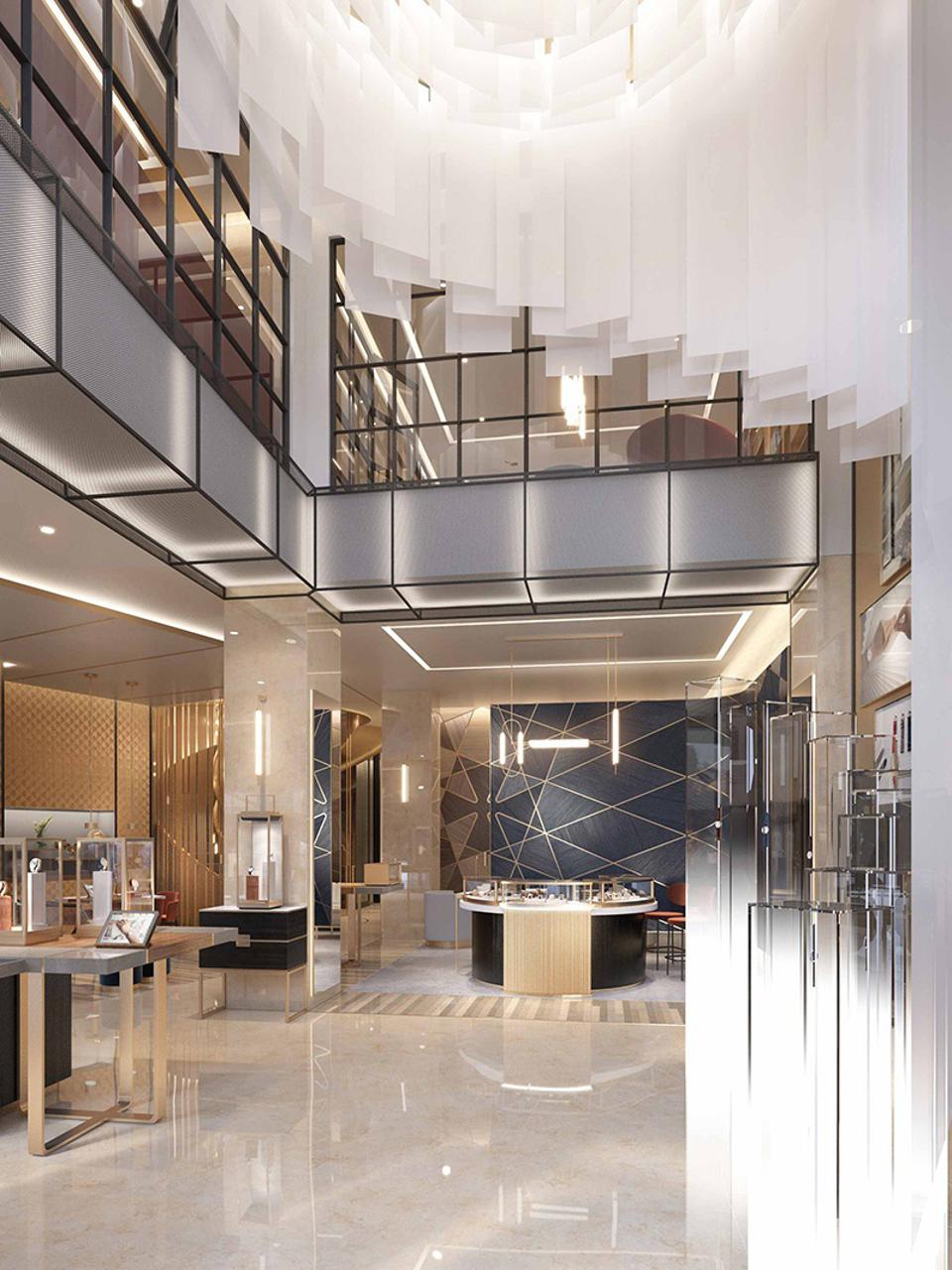 A staircase leads to the second floor lounge area and the strap customization center.