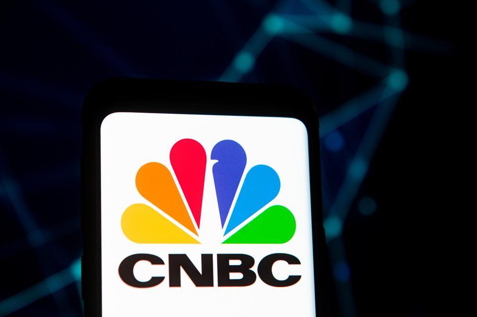 Photo illustration of CNBC logo on smartphone