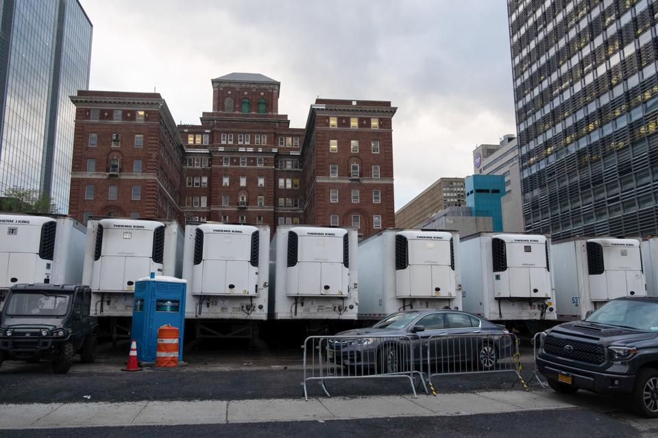Freezer trucks across the city serve as mobile morgues to accommodate an onslaught of Covid-19 victims. The state is at its peak reporting over 1,000 new deaths a day.