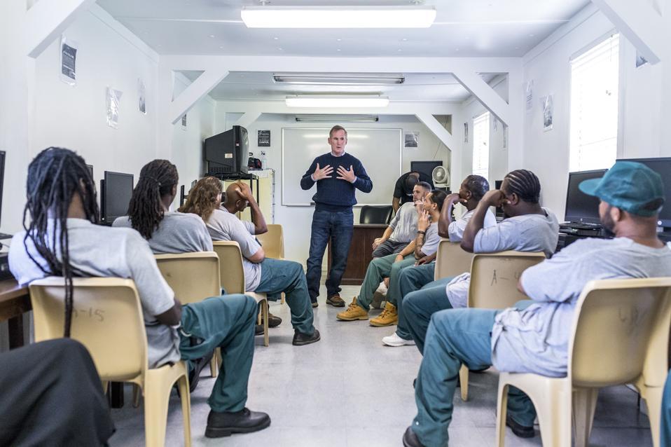 Brian Hamilton teaching inmates