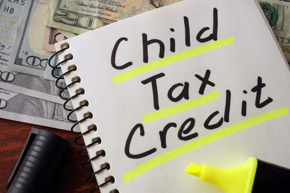 Notebook with child tax credit sign on a table.