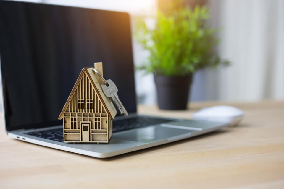Concept shopping online,House model on laptop