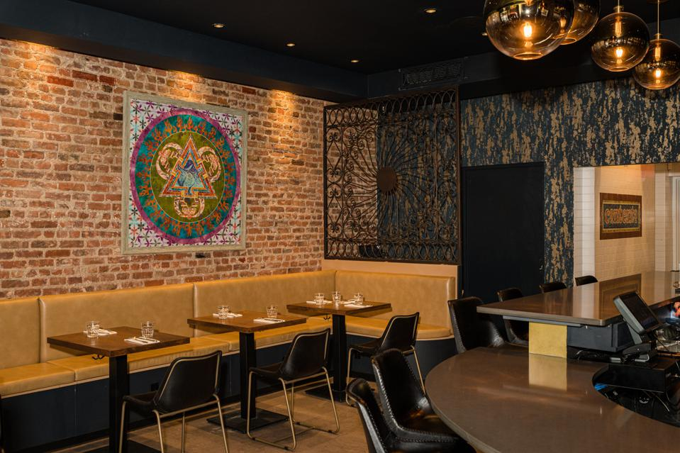 Fewer tables and a wider aisle allow greater accessibility at Contento in East Harlem.