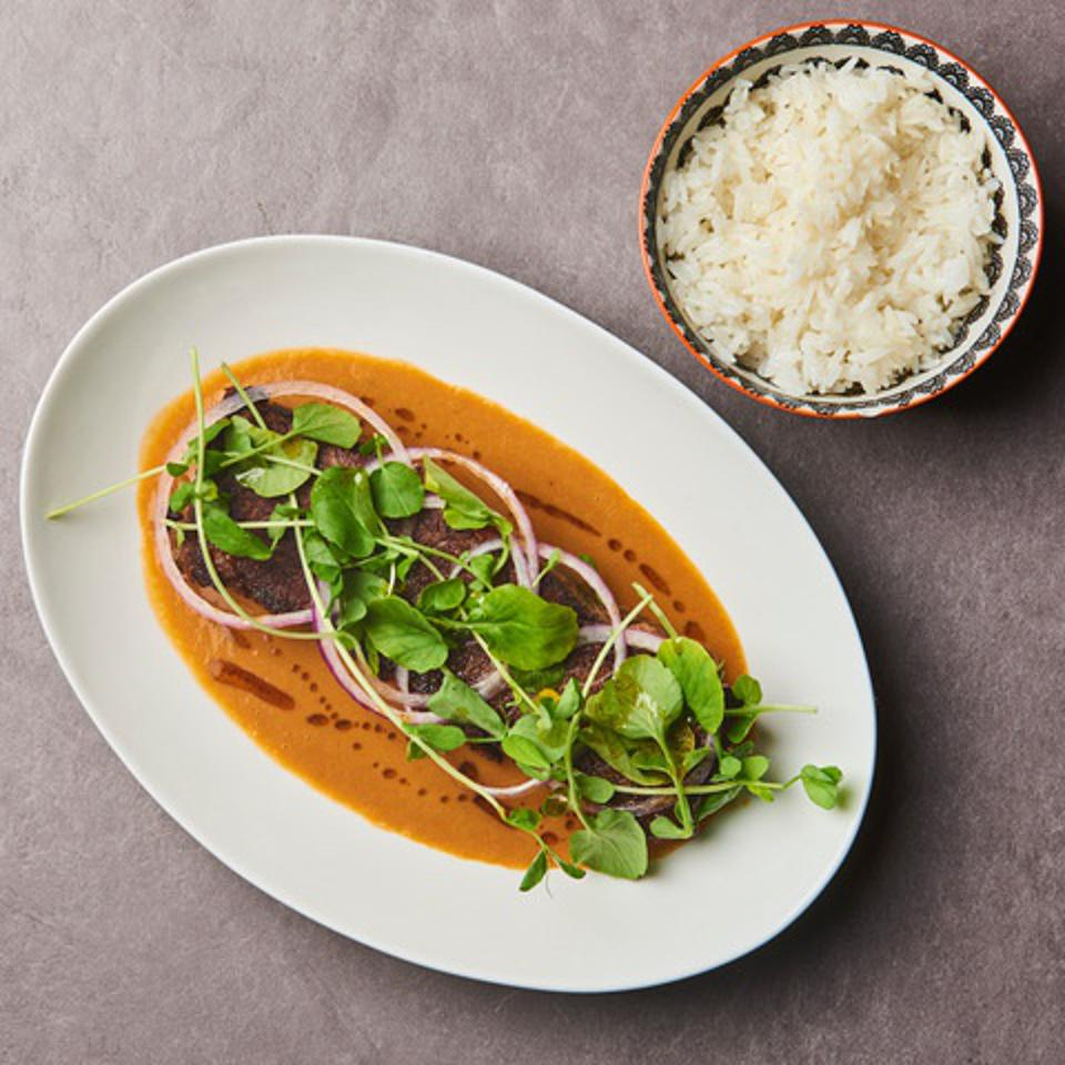 Chef Oscar Lorenzzi's short ribs in peanut sauce with a side of jasmine rice.