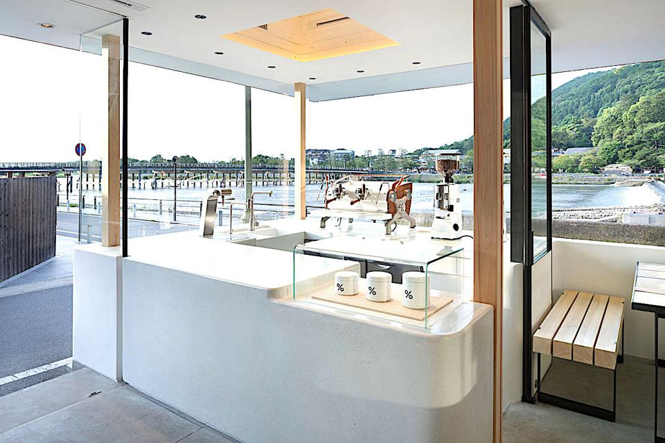 The flagship café of %Arabica in Kyoto overlooks the iconic Togetsukyo Bridge.