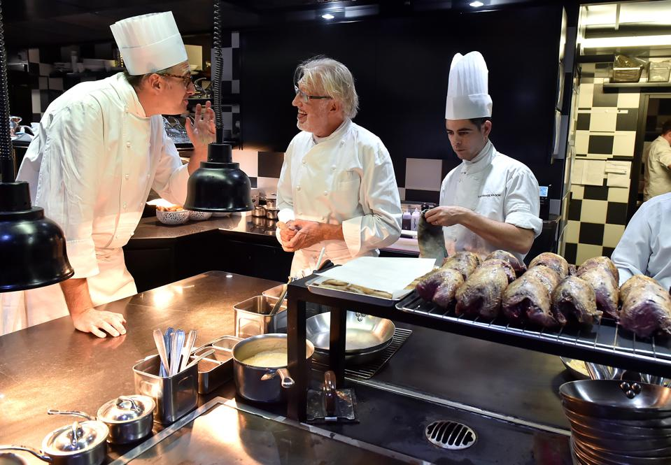 Newly appointed head chef of ″La Grande Maison″ restaurant Pierre Gagnaire (C) speaks with his executive chef Jean-Denis Le Bras in the kitchens of the restaurant in Bordeaux, on September 29, 2016. / AFP / GEORGES GOBET (Photo credit should read GEORGES GOBET/AFP/Getty Images)