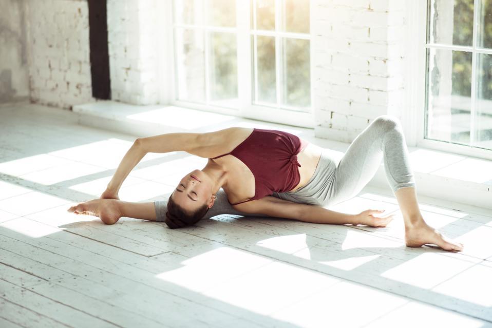 Flexible girl doing a yoga posture