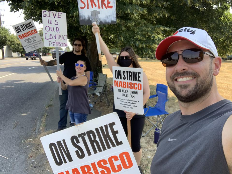 BCGTM Local 364 Vice President Mike Burlingham with co-workers in Portlan, Oregon on the picket line.