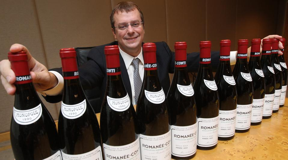 John Kapon, CEO of Acker Merrall & Condit Companies poses for photography with a full case of the legendary 1990 Romanee-Conti (estimate : HK$1,200,000-1,600,000/US$ 150,000-200,000), during a media briefing of Acker Merrall & Condit September HK Wine Auc