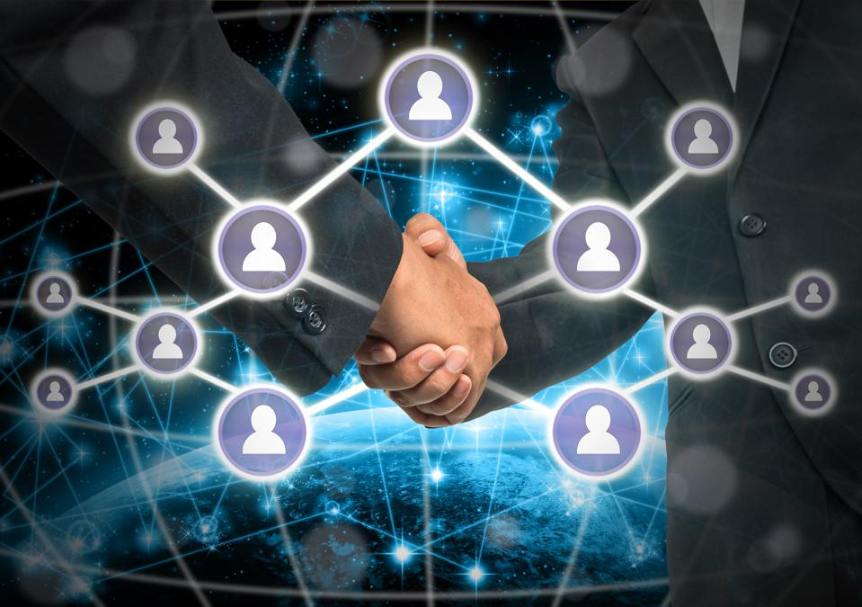 Business handshake with Social media symbol over Internet network concept background, Elements of this image furnished by NASA, Business social netwok concept
