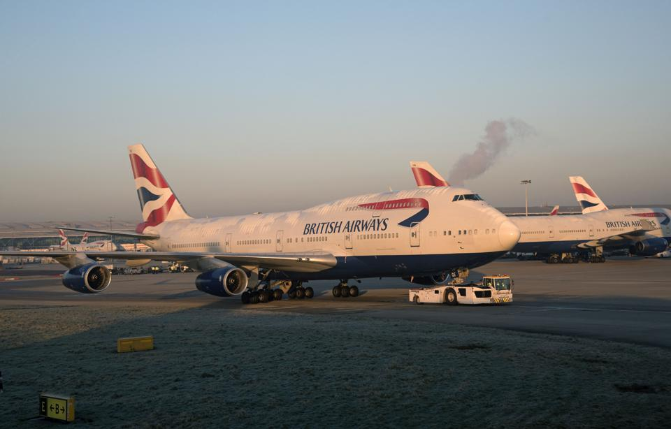 Passenger Jet Being Towed by a Tractor at London Airport Uk