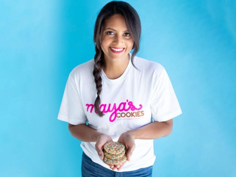 Mayas Cookies founder Maya Madsen holding 3 cookies