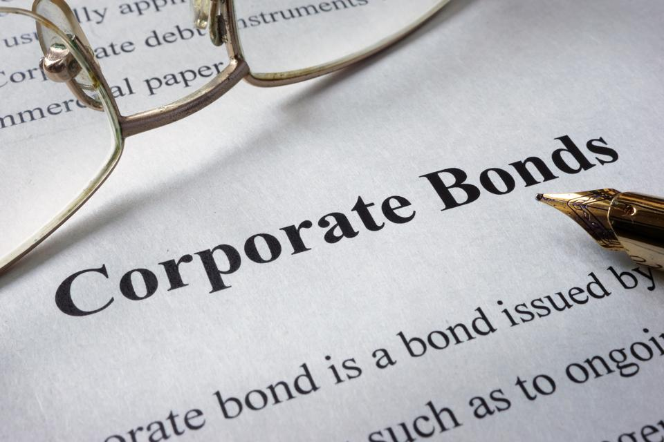 Page of newspaper with words corporate bonds.