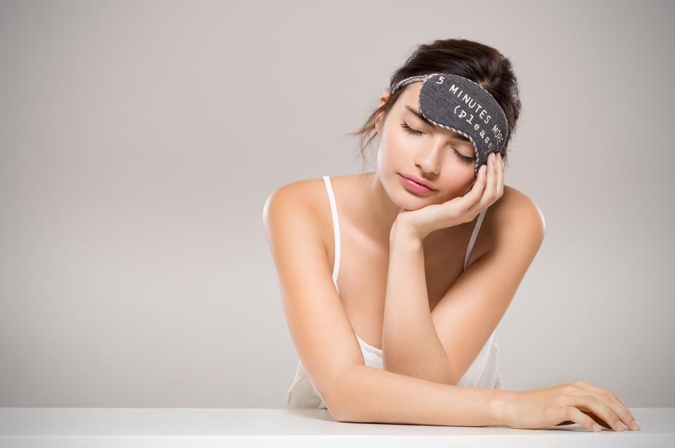 Sleeping woman wearing eye mask