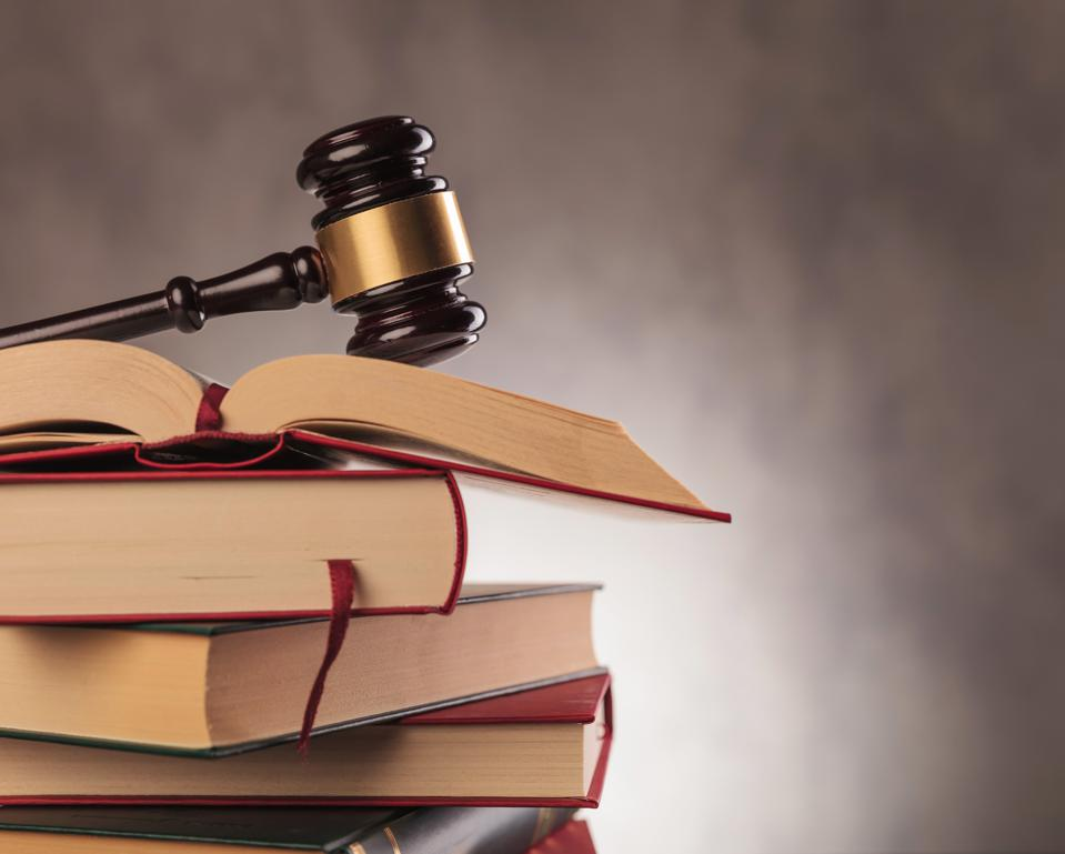 judge's gavel on top  of books with copyspace