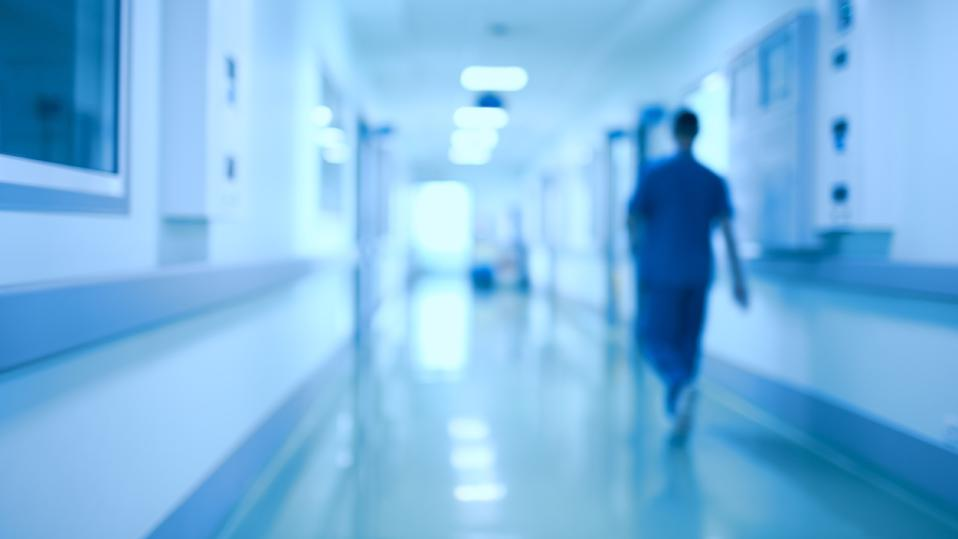 Hospital corridor and doctor as a blurred defocused background
