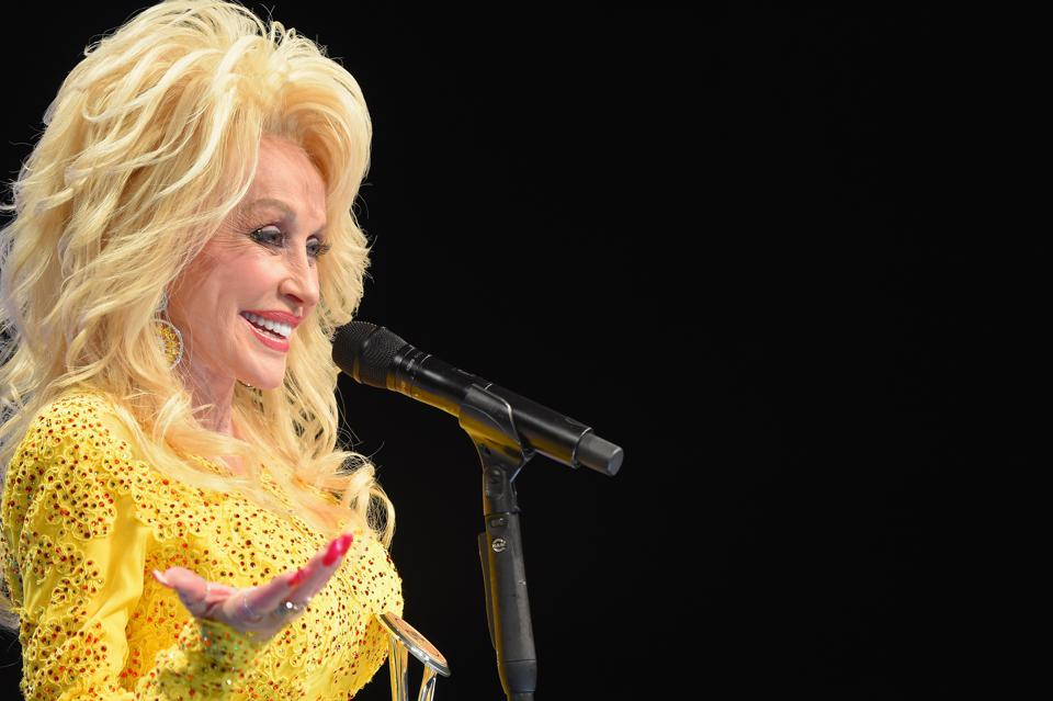 Dolly Parton Pledges $1,000 A Month To Homeless Victims Of Tennessee Wildfires