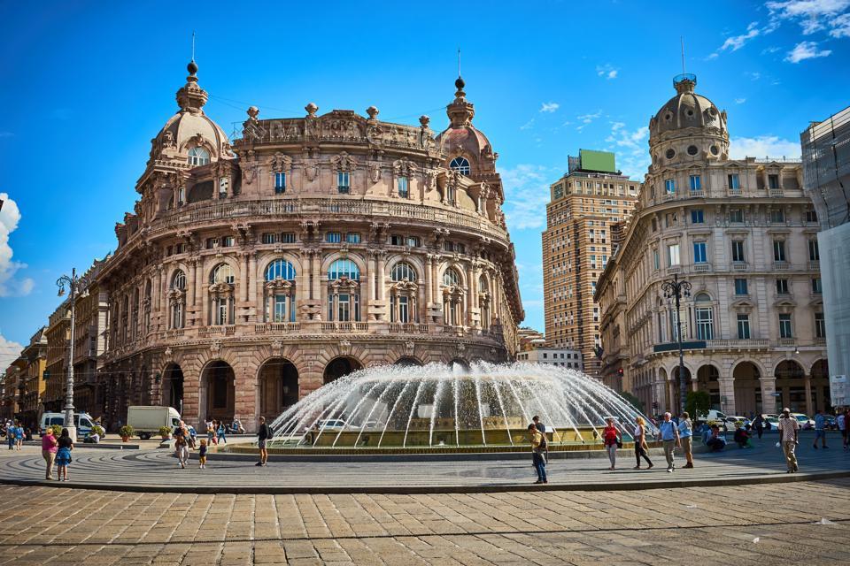 ″Palazzo della Borsa″, great fountain at central Place in Genoa