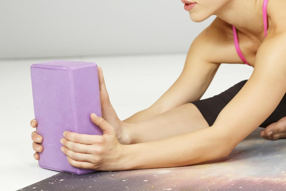 Keep your blocks within reach to bring the floor closer to you during yoga.