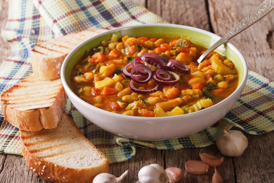Tuscan ribollita thick soup with bread closeup on the table