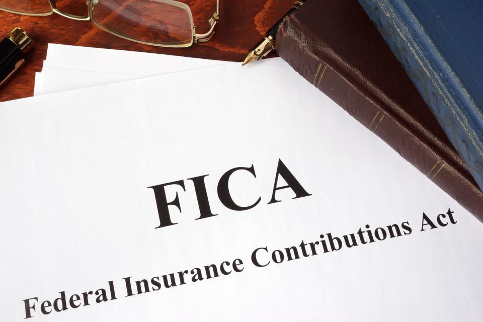 Papers with FICA Federal Insurance Contributions Act tax.