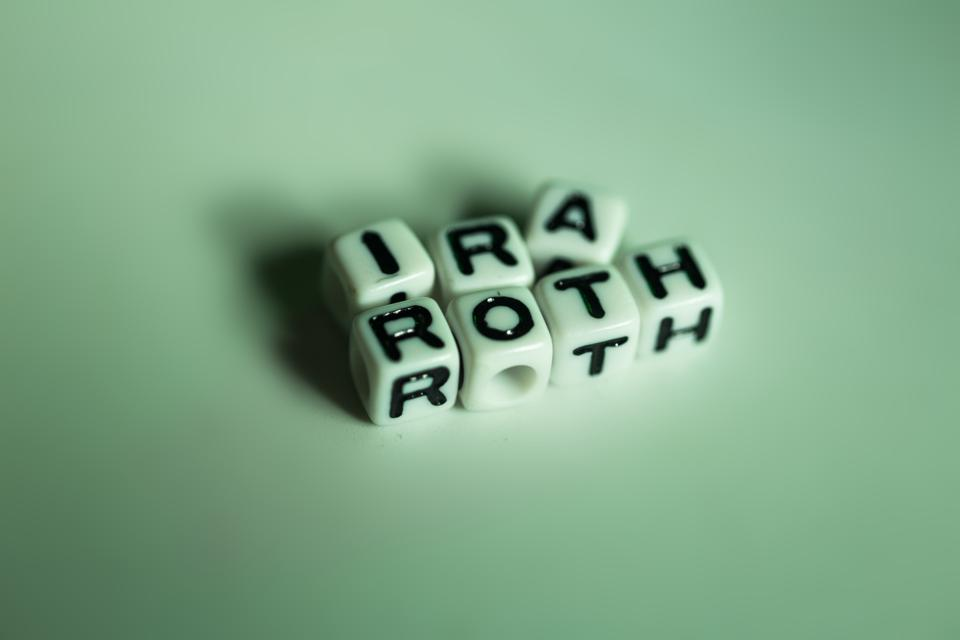 IRA roth cubic letter on white table