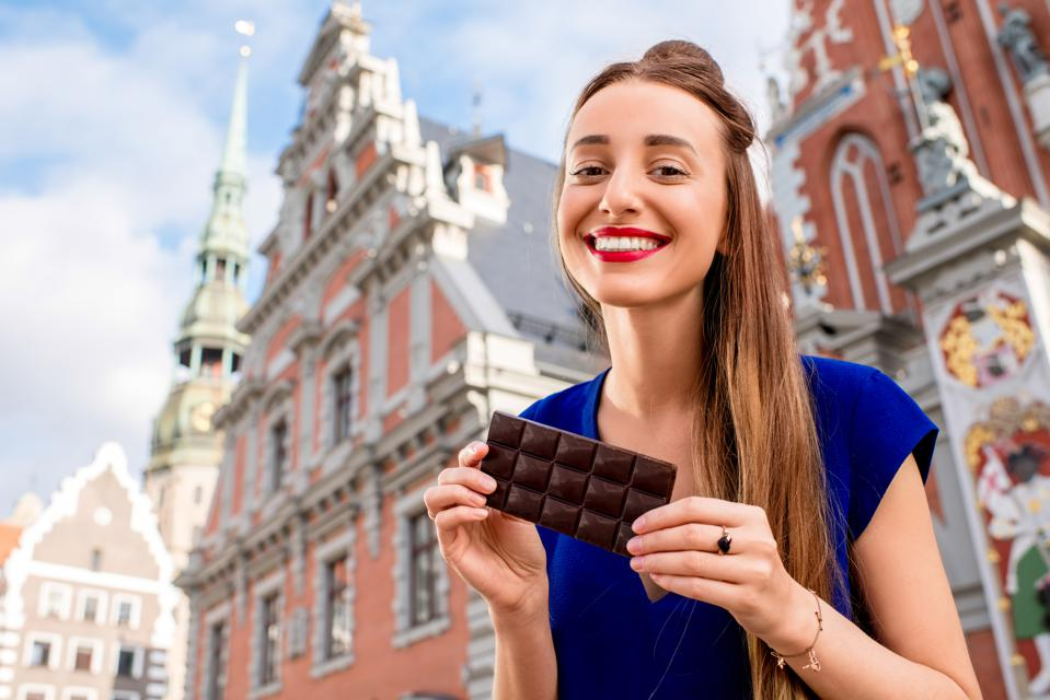 Woman with chocolate in Riga city