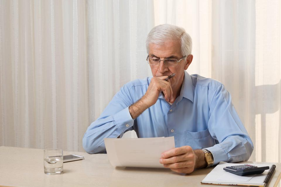Older man doing his taxes