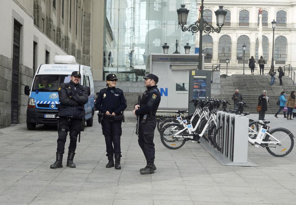 Policemen and Policewoman Talking, Madrid, Spain
