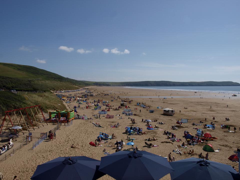 sandy beach, umbrellas and sunbathers