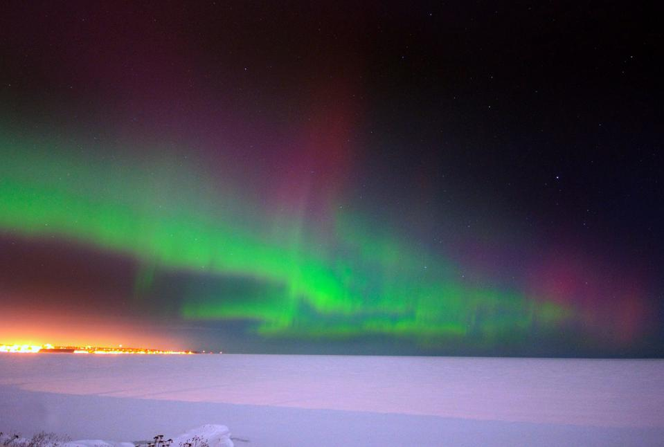 Photograph of the Northern Lights over the frozen Lake Superior, Michigan, Marquette
