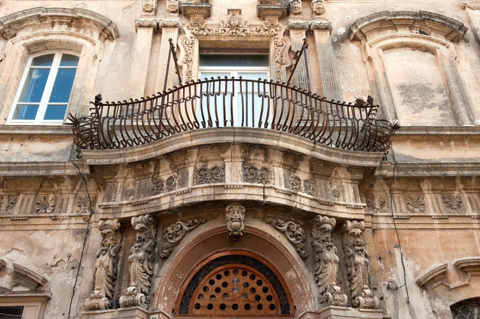 Italy. Sicily. Modica. Detail Of An Old Palace Facade Italy. Sicily. Modica. Detail Of An Old Palace Facade. (Photo by: Lorenzo De Simone/AGF/Universal Images Group via Getty Images)