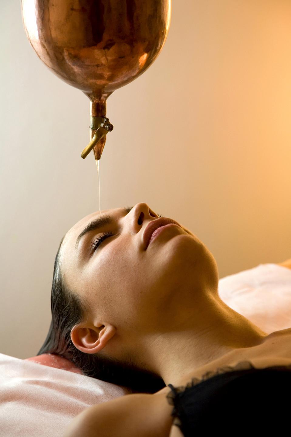 Woman Getting Ayurvedic Oil Treatment (shirodara)