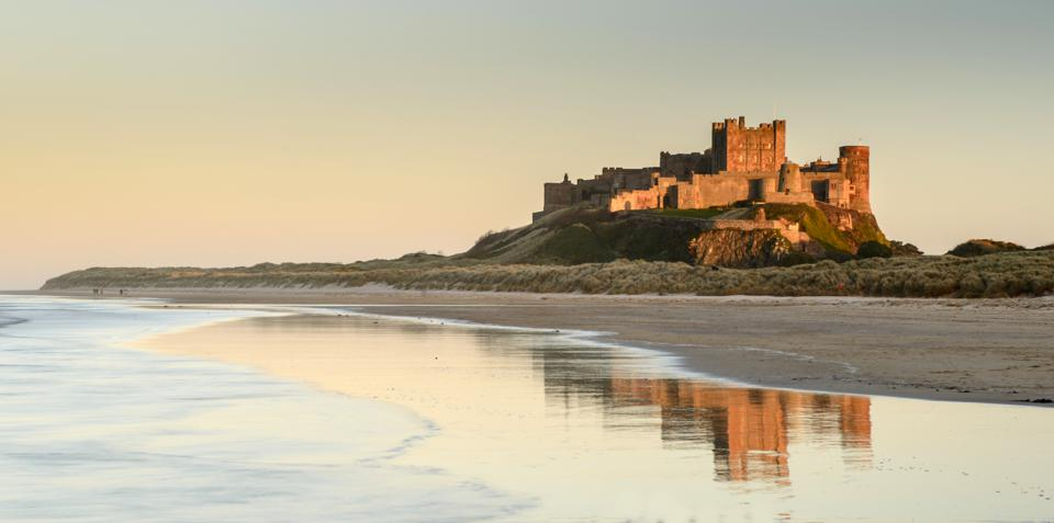 A view of Bamburgh Castle on the beach in Northumberland.