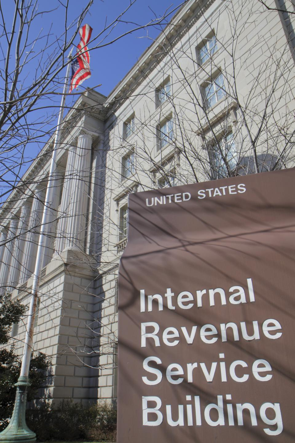 Internal Revenue Service sign outside a government office building.