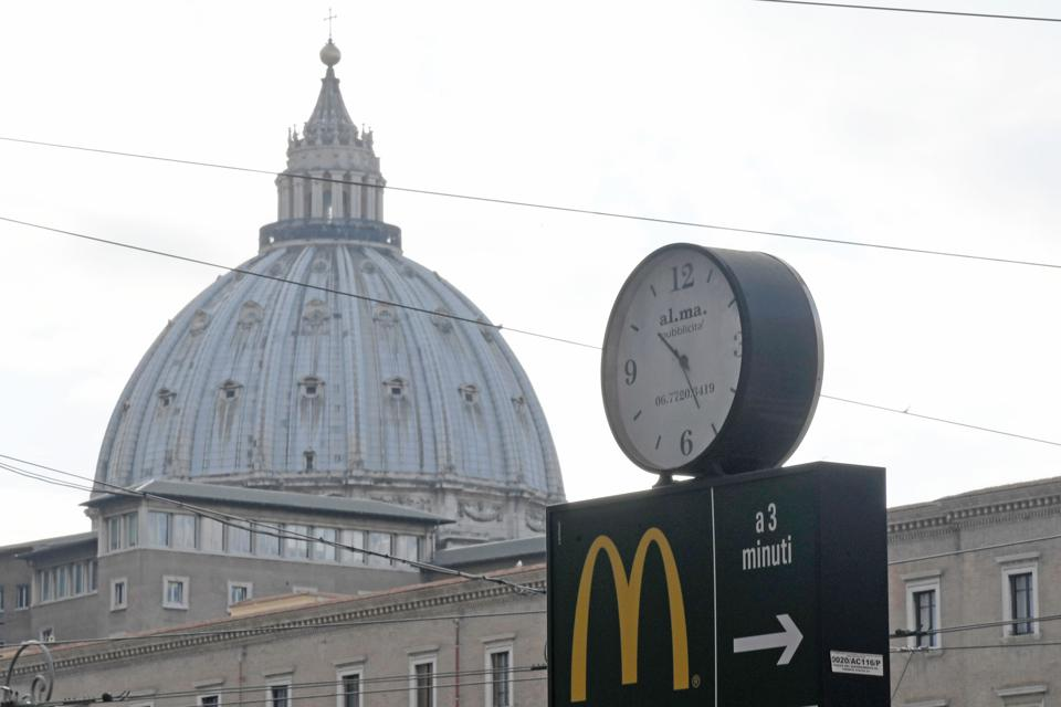 A McDonald's sign with St Peter's basilica in the background